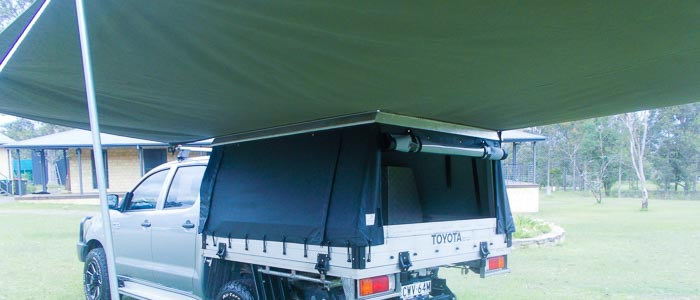 a canvas canopy with a hard aluminium or steel top makes perfect sense for loading above and stopping water pooling